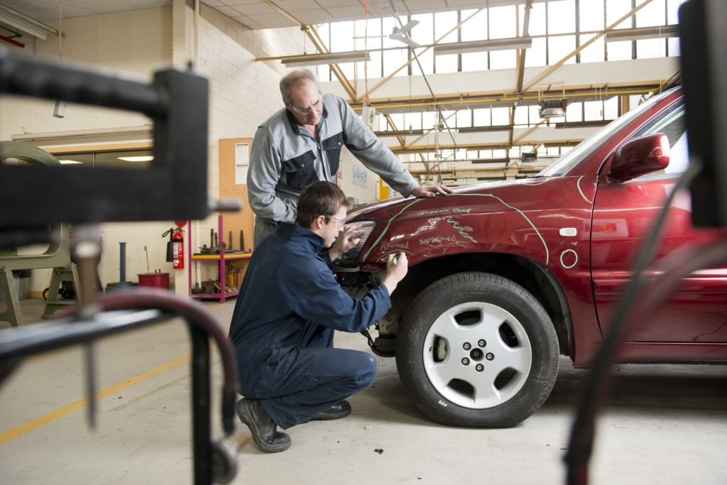 Collision repair business owners know how to fix a vehicle covered by car insurance, but they might not be as informed about what can cover their business. (Peter M. Fisher/Fuse/Thinkstock)