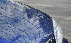 Nationwide's new Automated Mobile Hail Estimating system is a trailer-sized device pulled to an area with widespread hail damage, and policyholders drive battered vehicles through it like at a car wash. (Elenarts/iStock/Thinkstock)