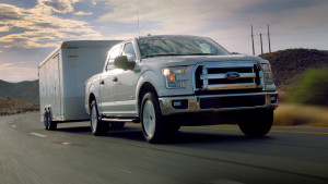 A 2015 Ford F-150 tows a trailer up a steep slope in triple-digit heat. (Provided by Ford)