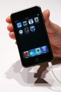 The new iPod Touch is held at the U.K. launch of the product at the BBC on Sept. 5, 2007 in London, England. Quik Video uses iPod Touches and mics to film needed auto repair work for customers. (Cate Gillon/Getty Images/Thinkstock file)