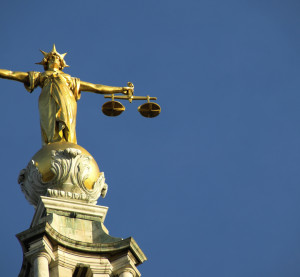 The scales of justice atop the Old Bailey. (Anthony Baggett/iStock/Thinkstock)