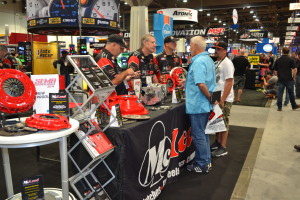 Racing and Performance exhibitors work booths at the 2014 SEMA Show. (Provided by SEMA)