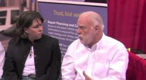 Dale Delmage, right, is seen in this 2011 Collision Hub video screenshot talking with Collision Hub CEO Kristen Felder, left. (Screenshot of Collision Hub video)