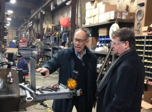 The Federal Vehicle Cost Savings Act, introduced Feb. 26 by U.S. Sens Gary Peters, D-Mich., right, encourages remanufactured parts in government vehicles. It unanimously passed the Senate Homeland Security Committee on Wednesday. (Provided by U.S. Sen. Gary Peters)
