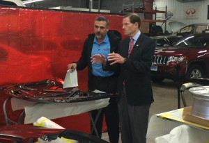 U.S. Sen. Richard Blumenthal, D-Conn., right, speaks to  A&R Body Specialty and Collision Works owner Tony Ferriaolo on Saturday at Ferriaolo's shop. (Emily Walsh/Sen. Blumenthal's office)