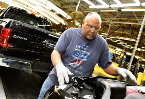 Ford employee Ronald Wolfskill inspects a 2015 Ford F-150 built at the Kansas City Assembly Plant. (Sam VarnHagen/Provided by Ford)