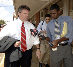 Democratic Mississippi Attorney General Jim Hood, left, talks to a news reporter as he leaves the Neshoba County Courthouse in the first day of jury selection in the trial of Edgar Ray Killen on June 13, 2005, in Philadelphia, Miss. (Marianne Todd/Getty Images News/Thinkstock file)