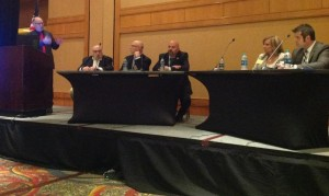 Moderator Rich Tuuri of AudaExplore addresses a CIC panel on Class A requirements. (John Huetter/Repairer Driven News)