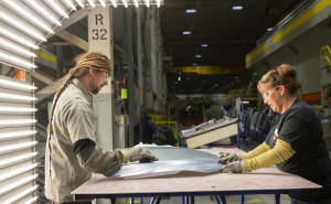 Kent Franklyn, left, and Katrina Elkins check the hood of a Chevrolet Sonic on April 30, 2015, at the Pontiac Metal Center, which will received $124 million from General Motors. (John F. Martin/General Motors/© Copyright General Motors)