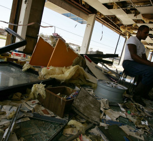 Ivan Anthony Richard reads a newspaper Sept. 7, 2005, in Bay St. Louis, Miss., Thousands of residents of the Gulf Coast are still without electricity or access to basic amenities after the devastating hurricane Katrina that has claimed the lives of thousands.  (Spencer Platt/Getty Images News/Thinkstock file)