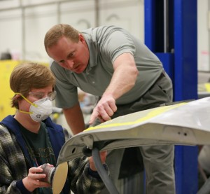 Wallace State Community College Collision Repair head Tim Grace works with a student. (Provided by Wallace State Community College)
