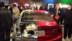 This cutaway model of the 2015 Acura TLX shows the interior. The tan is 590-megapascal steel, and the purple instrument panel is made of magnesium. (John Huetter/Repairer Driven News)