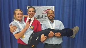 2015 SkillsUSA post-secondary automotive refinishing medalist Amanda Baker of Saint Louis-based Ranken Tech College is held by other refinishing medalists. (Provided by Chelsie Wilson, Dennis Technical Education Center)