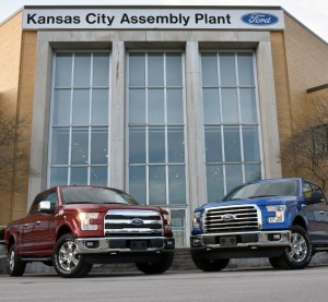 Two 2015 F-150s pose  March 13, 2015, outside the Kansas City Assembly Plant on the day it produced Job One of the 2015 F-150. (Sam VarnHagen/Provided by Ford)