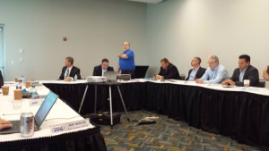 Society of Collision Repair Specialists Education Committee member Toby Chess (standing) speaks July 23, 2015. (John Huetter/Repairer Driven News)
