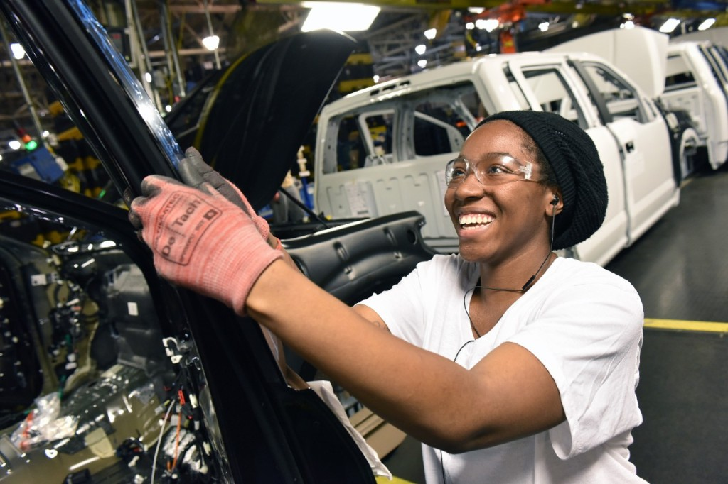Amber Clay works on Job One of the 2015 Ford F-150 at the Claycomo, Mo., plantt March 13, 2015. (Sam VarnHagen/Ford file)