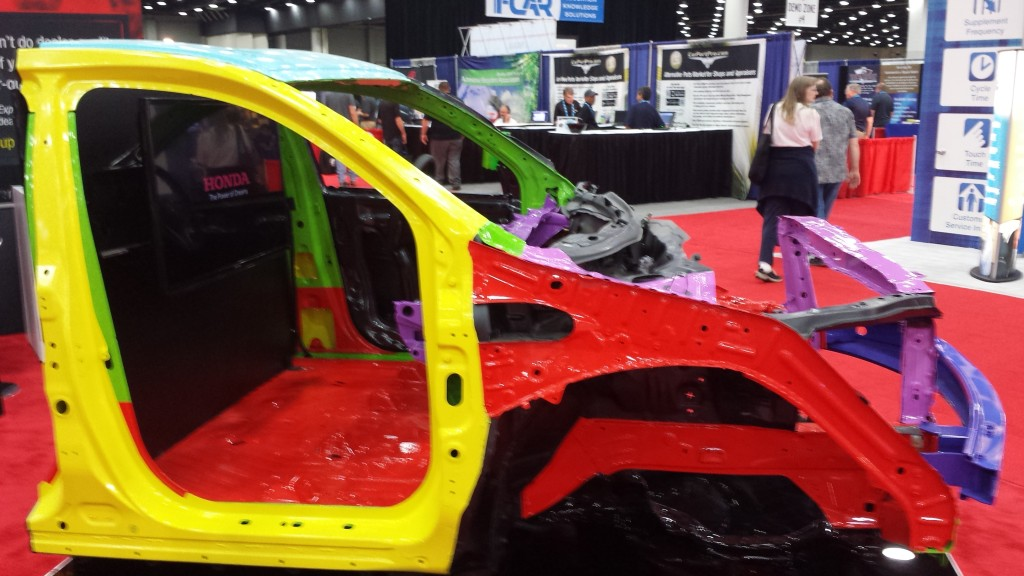 The 1,500-megapascal ultra-high-strength-steel door ring of a 2014 Acura MDX is shown in yellow at the July NACE CARS show. (John Huetter/Repairer Driven News)