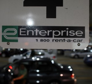 A sign hangs over the Enterprise car rental lot at the Fort Lauderdale/Hollywood International Airport July 10, 2007, in Fort Lauderdale, Fla. (Joe Raedle/Getty Images News/Thinkstock file)