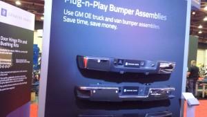 "A display at the 2015 NACE touts General Motors ""Plug-n-Play"" bumper sets. (John Huetter/Repairer Driven News)"