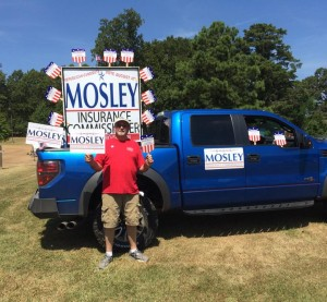 Clinton Body Shop owner John Mosley poses with campaign memorabilia in this undated photo posted Aug. 4, 2015, the date of his Republican primary against Insurance Commissioner Mike Chaney. (Provided by John Mosley via www.facebook.com)