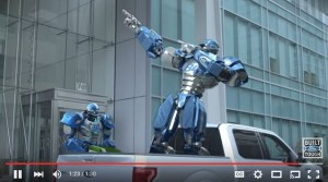 """An ad on Ford's YouTube channel features comedian Rob Riggle cutting a steel model of FOX NFL Sunday's mascot Cleatus and replaces him with an aluminum version. (Screenshot from """"Ford Tough"""" YouTube footage.)"""