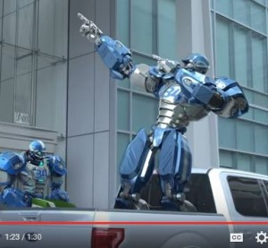 "An ad on Ford's YouTube channel features comedian Rob Riggle cutting a steel model of FOX NFL Sunday's mascot Cleatus and replaces him with an aluminum version. (Screenshot from ""Ford Tough"" YouTube footage.)"