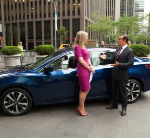 Nissan Chairman and CEO Carlos Ghosn shows off the mid-cycle redesigned 2016 Nissan Altima on Sept. 22, 2015. (Provided by Nissan)