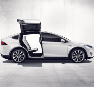 "The Tesla Model X SUV unveiled Tuesday to screaming fans is the ""safest SUV ever,"" CEO Elon Musk said, citing its standard autobraking and automaneuvering, lower probability of a rollover and reduced side impact potential. (Provided by Tesla)"