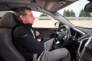 """General Motors researcher Jeremy Salinger road tests a Cadillac """"Super Cruise"""" partially self-driving vehicle in March 23, 2012. (John F. Martin for Cadillac/Copyright General Motors)"""