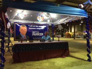 Louisiana insurance commissioner candidate Matt Parker poses in his booth at the Crawfish and Gatorfest event. (Provided by Parker campaign)