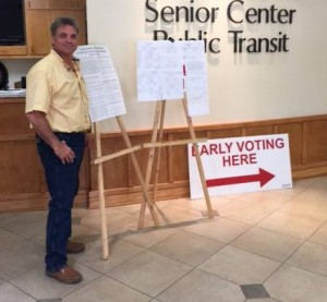 Parker Auto Body owner Matt Parker, a Republican, poses at an early voting location. (Provided by Parker campaign)