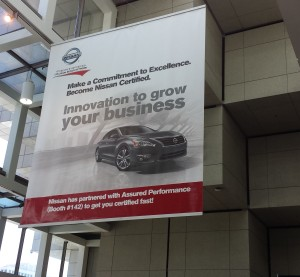 A banner touts Nissan certification in the Cobo Center during NACE 2015. (John Huetter/Repairer Driven News)