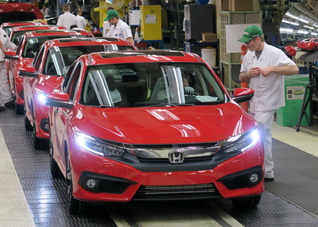 Honda of Canada staff inspect the 2016 Civic Sedan. (Provided by Honda)