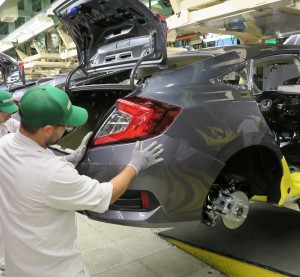 Honda of Canada staff install a rear bumper fascia on a 2016 Civic Sedan. (Provided by Honda)