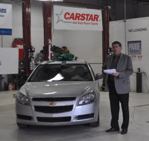 Dan Young, CARSTAR's new brand president as of Nov. 20, participates in a CARSTAR Recyled Rides event at the Kansas City-area  CARSTAR Metcalf R&D Center in this undated photo. (Provided by CARSTAR)