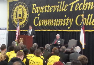 Republican Gov. Pat McCrory, left, speaks at the February 2015 grand opening of the Fayetteville Technical Community College collision repair program. (Provided by Margee Herring)