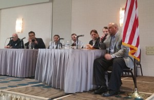 OPSTRAX CEO Nick Bossinakis, right, speaks at an electronic parts procurement panel Jan. 14, 2016, at the Collision Industry Conference.  (John Huetter/Repairer Driven News)
