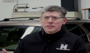In this still from video submitted to the Pennsylvania Banking and Insurance Committee, Mark Vettori, president of Hunt Collision Services, described incident in which a photo appraisal missed significant damage rendering a Honda CR-V unsafe to drive. (Screenshot from Committee Chairman Don White's video on www.senatordonwhite.com)