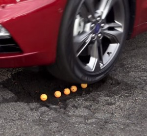 "A standard feature on the 2017 Ford Fusion Sport keeps watch for potholes and stiffens the shocks ""faster than the blink of an eye"" to effectively skip the car over them, Ford announced Thursday. (Screenshot of video from Ford Media YouTube channel)"
