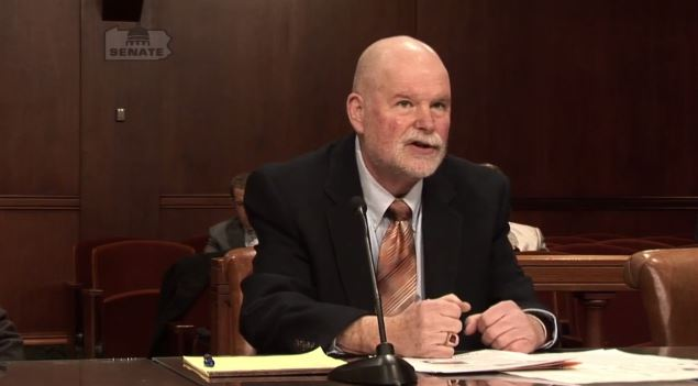 PCTG director Steven Behrndt discusses reconditioned wheels in this screenshot from video of a Pennsylvania Banking and Insurance Committee hearing provided by Chairman Don White. (Screenshot from www.senatordonwhite.com)