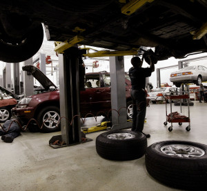 Tyrone Browley replaces the brakes on a Lexus LX470 at a dealership July 10, 2003, in Chicago. (Scott Olson/Getty Images News/Thinkstock file)