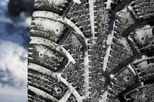 Studded tires are shown in snow. (Kichigin/iStock/Thinkstock)