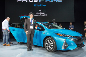 2017 Toyota Prius Prime chief engineer Koji Toyoshima and his vehicle appear March 23, 2016, at the  New York International Auto Show. (Provided by Toyota)