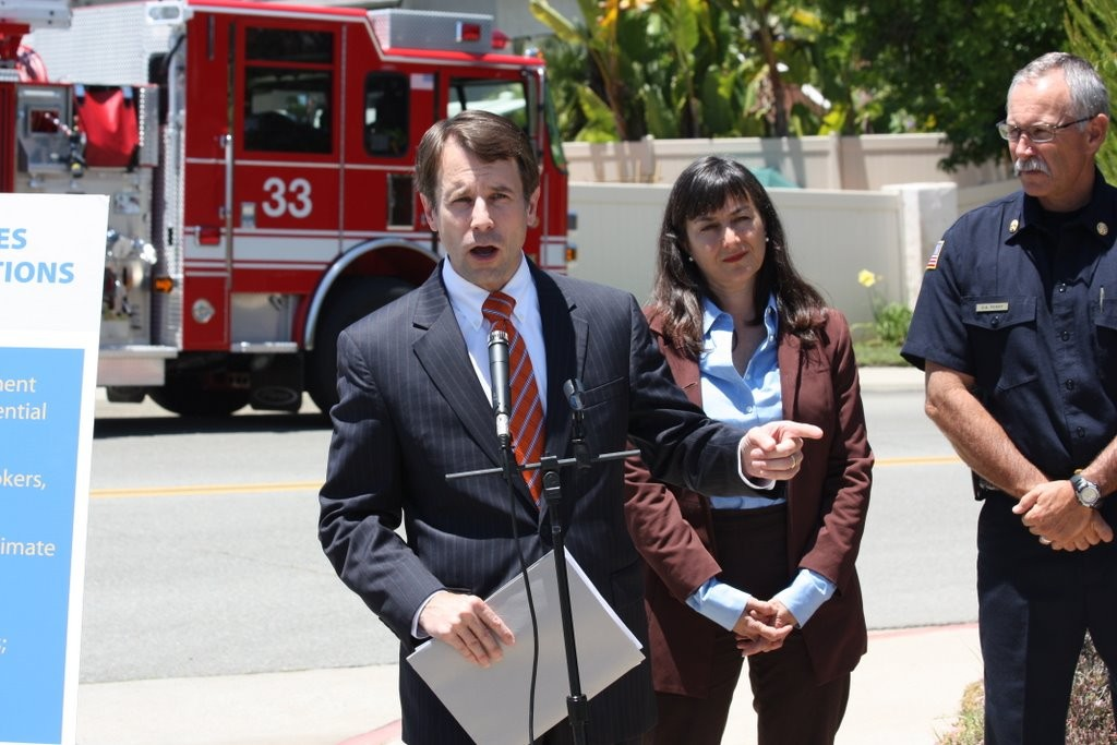 Democratic Insurance Commissioner Dave Jones, left, speaks in 2011. (Dave Althausen/California insurance commissioner's office file)