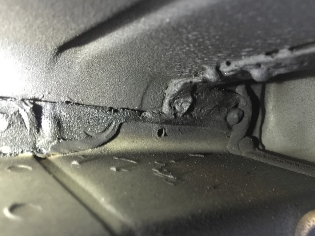 "Ascue's Auto Body & Paint Shop operations manager Jordan Wooten said this image shows a failure to weld a screw hole, and ""that panel's actually just separated right there."" (Provided by Ascue's Auto Body)"