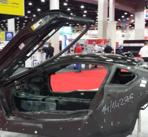 The body of the carbon-fiber BMW i8 is on display at NACE. Mitsubishi Rayon supplies the precursor for the carbon-fiber. (John Huetter/Repairer Driven News)