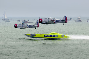 The 'Geico Skytypers' flying preforming precision aerial maneuvers with the 'Miss Geico' speedboat over the ocean at the Atlantic City Airshow in New Jersey on Sept. 2, 2015. (Aneese/iStock Editorial/Thinkstock file)