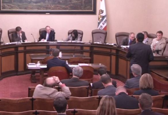 Association of California Insurance Companies government affairs outreach Vice President Armand Feliciano speaks against Democratic Insurance Commissioner Dave Jones' proposed auto body labor rate survey regulations at an April 27, 2016, California Senate joint committee hearing. (Provided by California Senate)