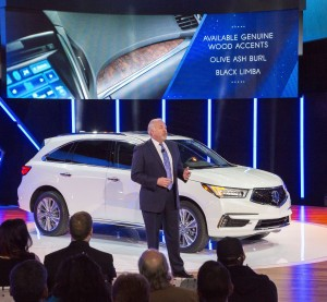 American Honda Executive Vice President John Mendel on March 23, 2016, shows the 2017 Acura MDX at the New York International Auto Show. (Provided by Honda)
