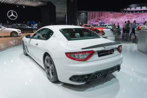 A Maserati GranTurismo MC sits near Mercedes and Infiniti displays on Nov. 19, 2015, at the Los Angeles Auto Show. (br-photo/iStock Editorial/Thinkstock file)